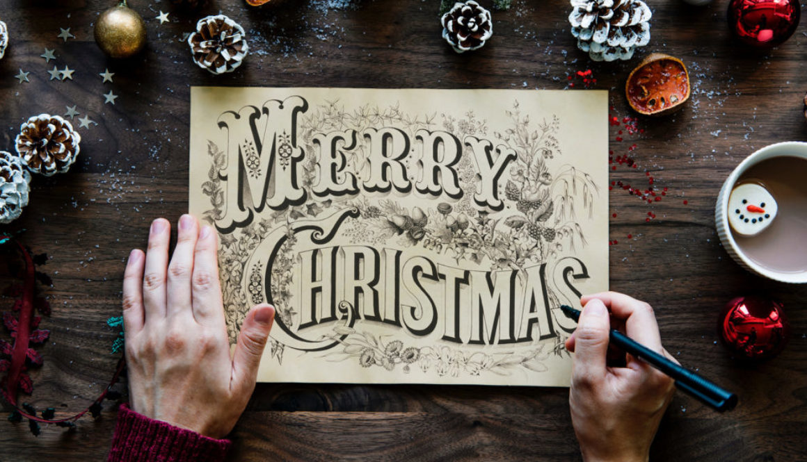 Merry Christmas Handwritten Design on Paper